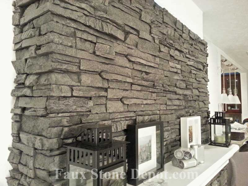 Example of imitation faux boards of stone applied to a fireplace remodeling